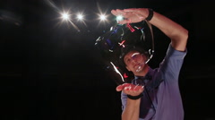 The man the actor stirs up a soap bubble. Soap bubbles show Stock Footage