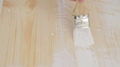 Wood painting with a brush - stock footage