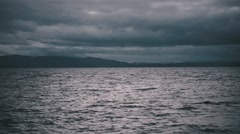 Dark sea, the backdrop of gloomy clouds Stock Footage