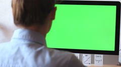 A freelancer working on a computer. On the monitor green screen, chroma key. Stock Footage