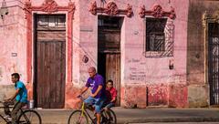 Men on bicycles in Cuban street Stock Photos