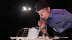 The man the actor blows figures from soap bubbles with gas. Soap bubbles show Stock Footage