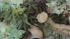 Florist girl making a flower composition Stock Footage