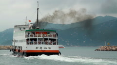 First Ferry leaving Cheung Chau island Stock Footage