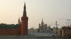 Tower of Moscow Kremlin and St Basil's Cathedral in sunset Stock Footage