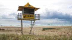 Lifeguard patrol tower on the Gold Coast, Queensland, Australia Stock Footage