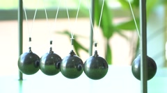 Slow motion. Newton's cradle: a pendulum with swinging metal spheres - stock footage