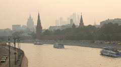 Tourist boats are floating on river near Moscow Kremlin in sunset time Stock Footage