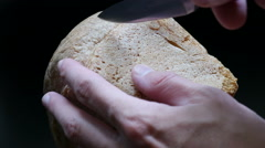 Cutting a slice of bread Stock Footage