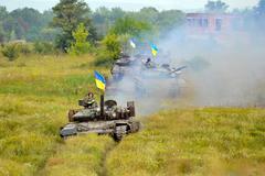 Main battle tanks under the Ukrainian flags Stock Photos