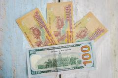 Vietnamese dong and american dollar usd Stock Photos