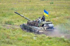 Main battle tank under the Ukrainian flag Stock Photos