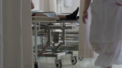 Patient in surgery operating room with medical equipment in a modern hospital Stock Footage