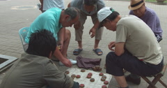 Men playing Chinese chess on street, Beijing Stock Footage