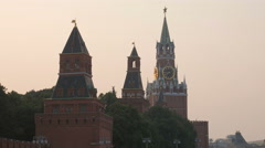 Beklemishevskaya and Spasskaya Tower of Moscow Kremlin in sunset Stock Footage