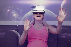 Young woman traveling in space using virtual reality glasses Stock Photos