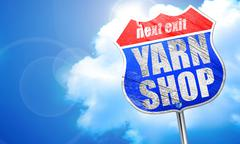 Yarn shop, 3D rendering, blue street sign Stock Illustration