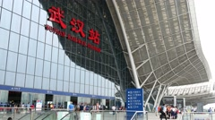 WUHAN, CHINA  high speed railway station entrance with signs & people Stock Footage