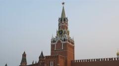 Spasskaya Tower in sunset, sky is tightened smoke in summer evening Stock Footage