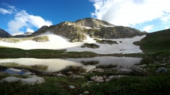 A picturesque mountain lake at the foot of the mountain Oshten. Stock Footage