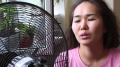 Girl cool about the fan Stock Footage