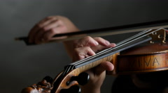 High quality shot of musician playing violin. Dark background. UHD 4K Stock Footage
