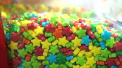 Multicolour pile of candy sweets food background, closeup view Stock Footage