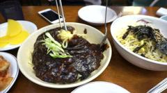 Jajangmyeon, Korean Noodles with blacken sauce with kimchi set Stock Footage