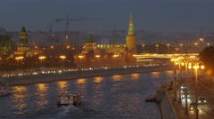 View of Moscow river in twilight time along embankment with pleasure craft, car Stock Footage
