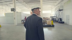 Joyful busnessman on industrial factory - stock footage