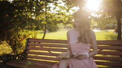 Romantic girl reading a book in the park Stock Footage