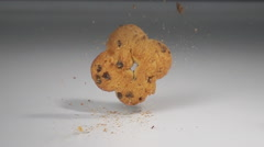 Biscuit falling on table slow motion Stock Footage
