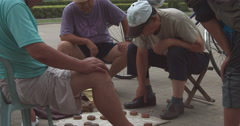 Chinese men playing xiangqi chess Stock Footage