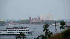 Boat Sails By Ellis Island Stock Footage