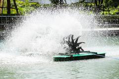 Water spin machine working in lake Stock Photos