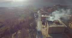 Drone footage of smoke emitting from building in old town, High Atlas, Morocco Stock Footage