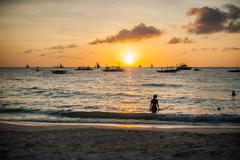 Sunset in Boracay, boat, girl Stock Photos
