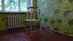 Two old wooden chairs standing one on second Stock Footage