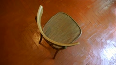 old wooden chair with back in an empty room - stock footage