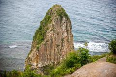 High acute Cliff by the sea Stock Photos