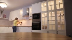 Cleaning white kitchen with beautiful lighting. Stock Footage