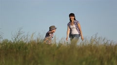 A little boy runs away from mom and dad, plays and has fun. Stock Footage