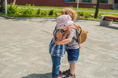 Toddlers Boy and girl hugging in summer park Stock Photos