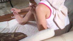 Beautiful woman's painting her nails at home Stock Footage