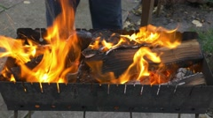 Burning wood and coal in the brazier. Preparing barbecue shish kebab and grill Stock Footage
