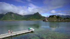 A mother and her son walking on a jetty in Lofoten, Norway Stock Footage