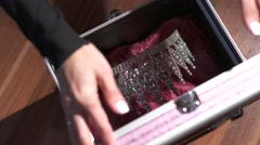Hands locking a briefcase with diadem Stock Footage
