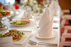 Table with white tablecloth Stock Photos