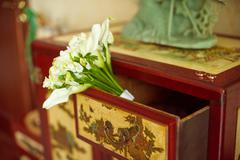 Wedding bouquet on the dresser - stock photo