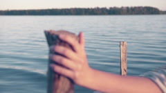 Hand on Wooden Jetty Pole Focus Pull Summertime - Graded Cinematic Look Stock Footage